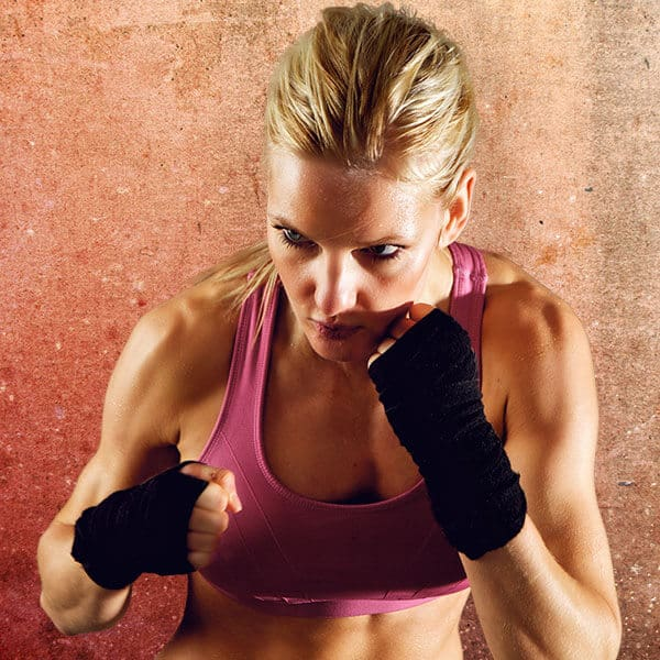 Mixed Martial Arts Lessons for Adults in Middle River MD - Lady Kickboxing Focused Background