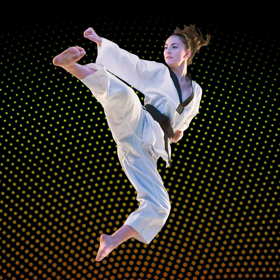 Martial Arts Lessons for Adults in Middle River MD - Girl Black Belt Jumping High Kick