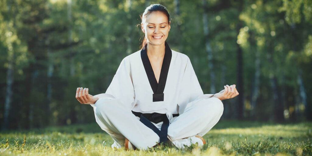 Martial Arts Lessons for Adults in Middle River MD - Happy Woman Meditated Sitting Background